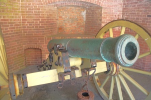 Cannon rests inside the masonry walls of the fort.
